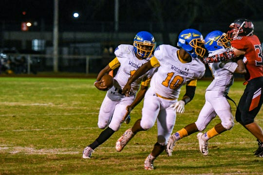 Wicomico High's Andre Matthews (1) runs the ball against Bennett at Wicomico County Stadium on Friday, Nov 2, 2018.