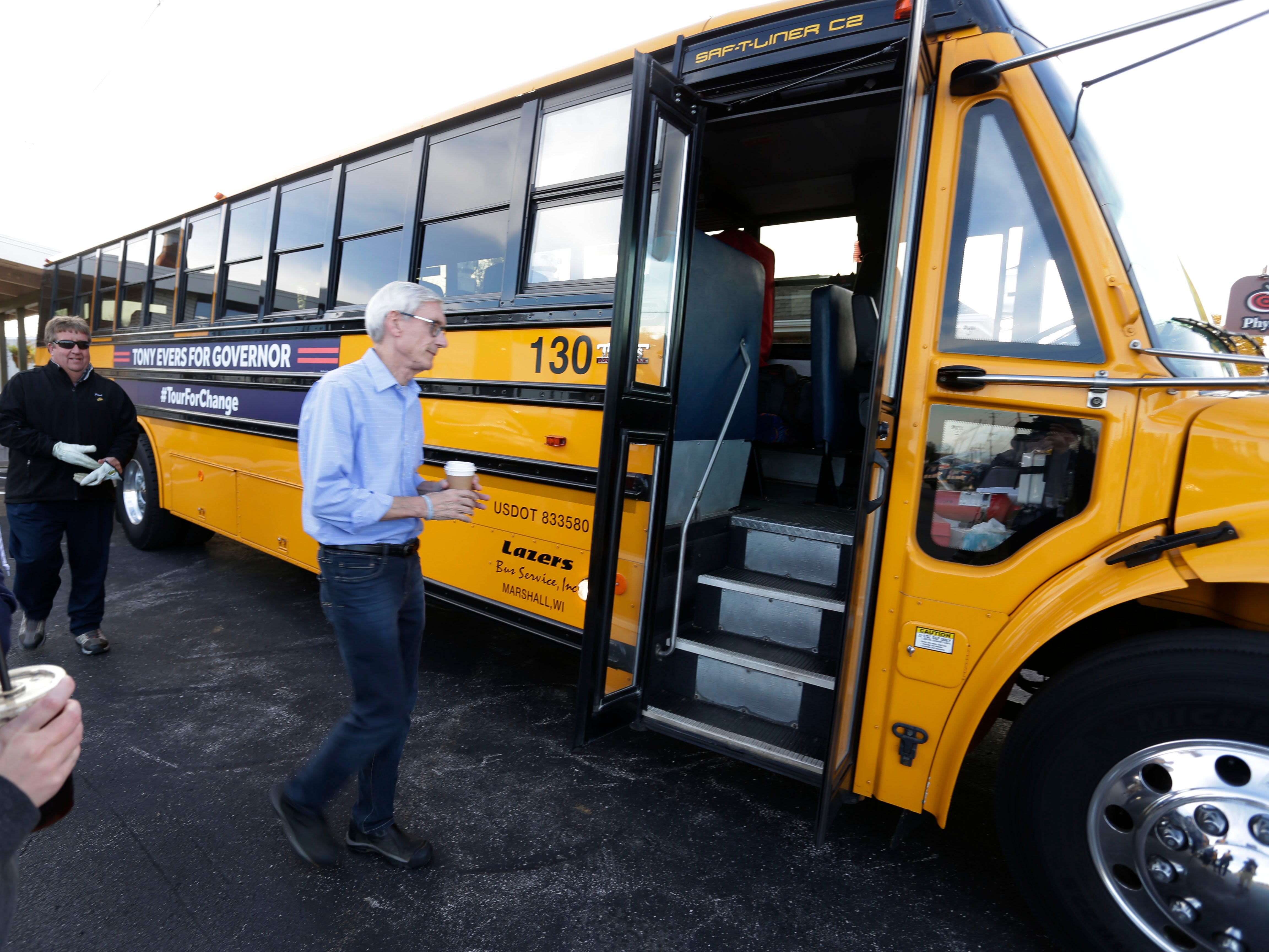 Gubernatorial candidate and Plymouth native Tony Evers, enters a school bus following a campaign stop at The Hub coffee shop, Saturday, November 3, 2018, in Plymouth, Wis.