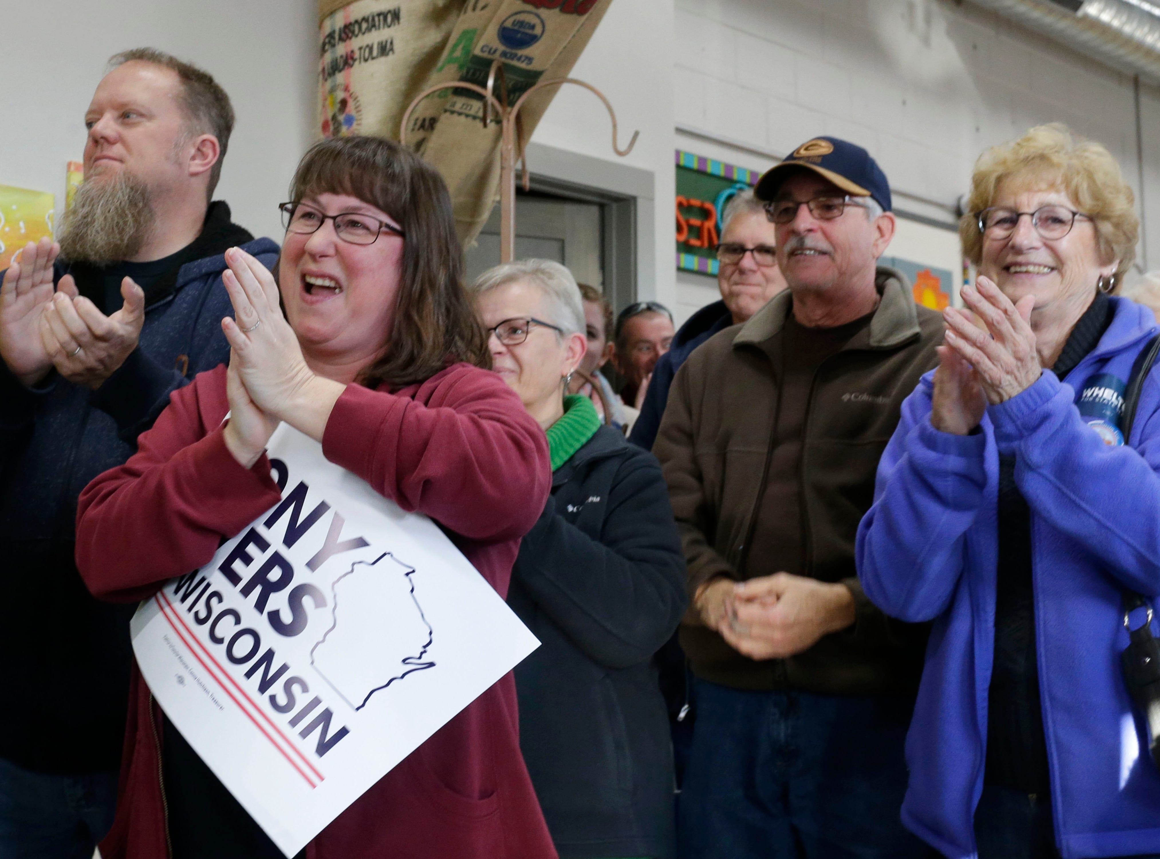 People clap during an introduction during Tony Ever's campaign stop at The Hub coffee shop, Saturday, November 3, 2018, in Plymouth, Wis.