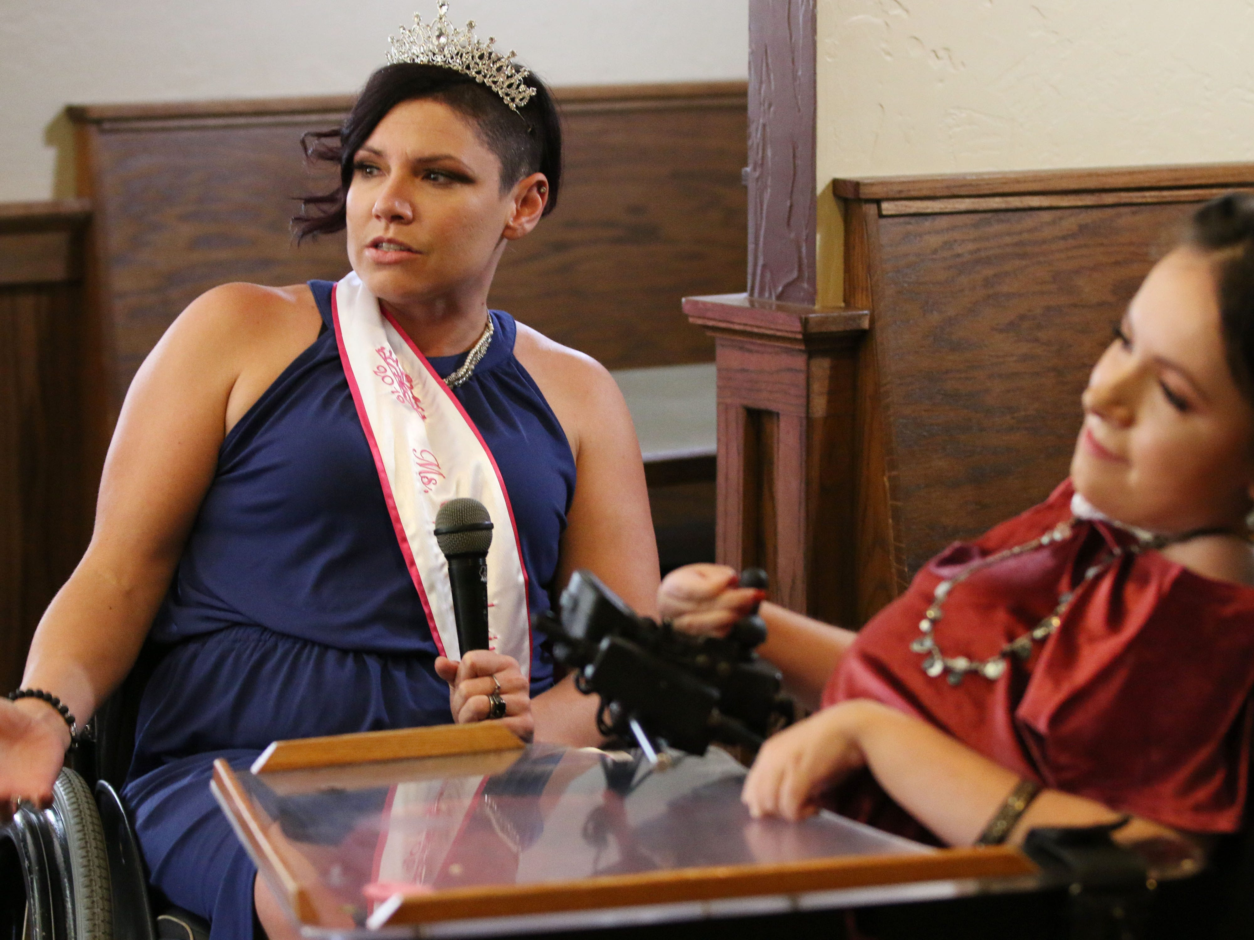 Autumn Neugent of Madison was named Ms Wheelchair Wisconsin, Saturday, November 3, 2018, in Plymouth, Wis. Neugent, left, was giving comments following her crowning next to runner up Amber Schmidt, of Merrill, Wis.