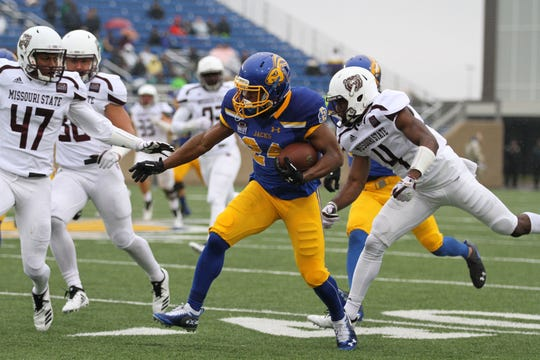 South Dakota State's Deyon Campbell (24) tries to evade Missouri State's Kam Carter (47) and Matt Rush after a big gain during the second quarter of the match up with Missouri State for Military Appreciatin Day Saturday afternoon at Dana J. Dykhouse Stadium in Brookings.