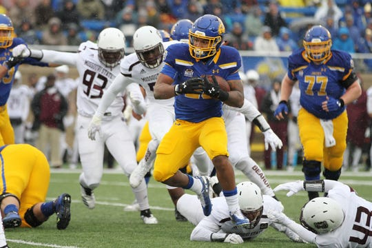South Dakota State's Mikey Daniel (26) runs for yards during the first quarter of the match up with Missouri State for Military Appreciatin Day Saturday afternoon at Dana J. Dykhouse Stadium in Brookings.