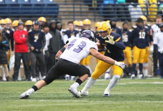 Jake Weisheimer of Augustana looks to avoid the tackle by David Smith of Winona State during Saturday's game in Sioux Falls.
