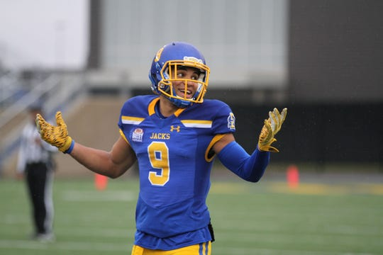 South Dakota State's Jordan Brown laughs in a conversation on the field during the second quarter of the match up with Missouri State for Military Appreciatin Day Saturday afternoon at Dana J. Dykhouse Stadium in Brookings.