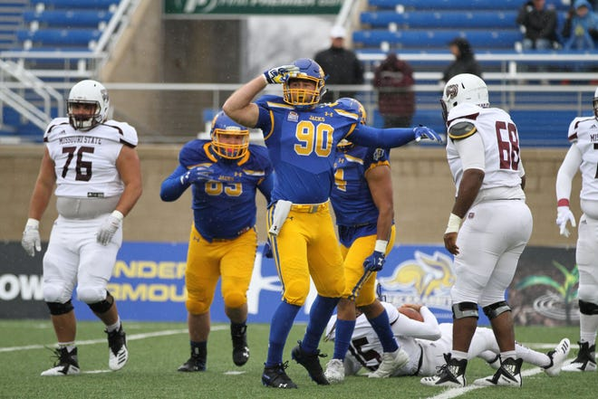 South Dakota State's Ryan Earith (90) gives a salute after a sack during the first quarter of the match up with Missouri State for Military Appreciatin Day Saturday afternoon at Dana J. Dykhouse Stadium in Brookings.