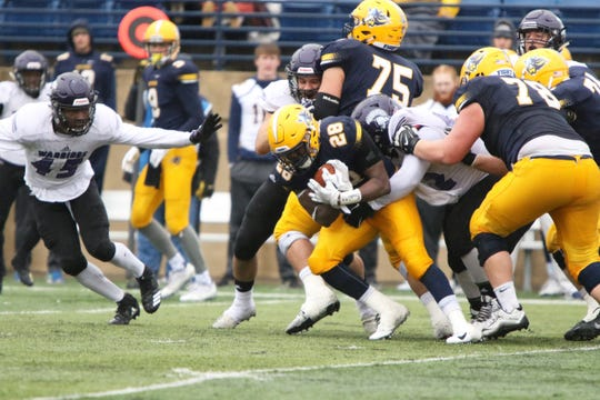 Rufdolh Sinflorant of Augustana is pulled down by Quinton Reed of Winona State after a short gain during Saturday's game in Sioux Falls.