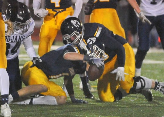 Tea's Carter Slykhuis recovers a fumble against West Central on Friday, Nov. 2, 2018, in Tea.