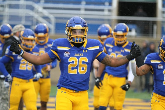 South Dakota State's Mikey Daniels gets warmed up before the match up with Missouri State Saturday afternoon at Dana J. Dykhouse Stadium in Brookings.