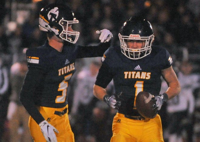 Tea's Carter Slykhuis is congratulated by teammate Brayden Thompson after recovering a fumble against West Central on Friday, Nov. 2, 2018, in Tea.