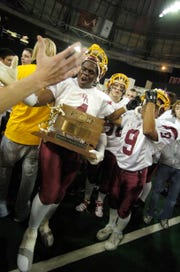 Preston Evans, celebrates the Rough Riders' victory over Washington for the 2007 Class 11AA state championship game.