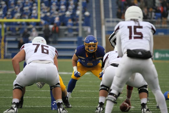 South Dakota State's Christain Rozeboom (2) eyeball's Missouri State quaterback Peyton Huslig before a play in the first quarter of the match up with the Bears for Military Appreciatin Day Saturday afternoon at Dana J. Dykhouse Stadium in Brookings.
