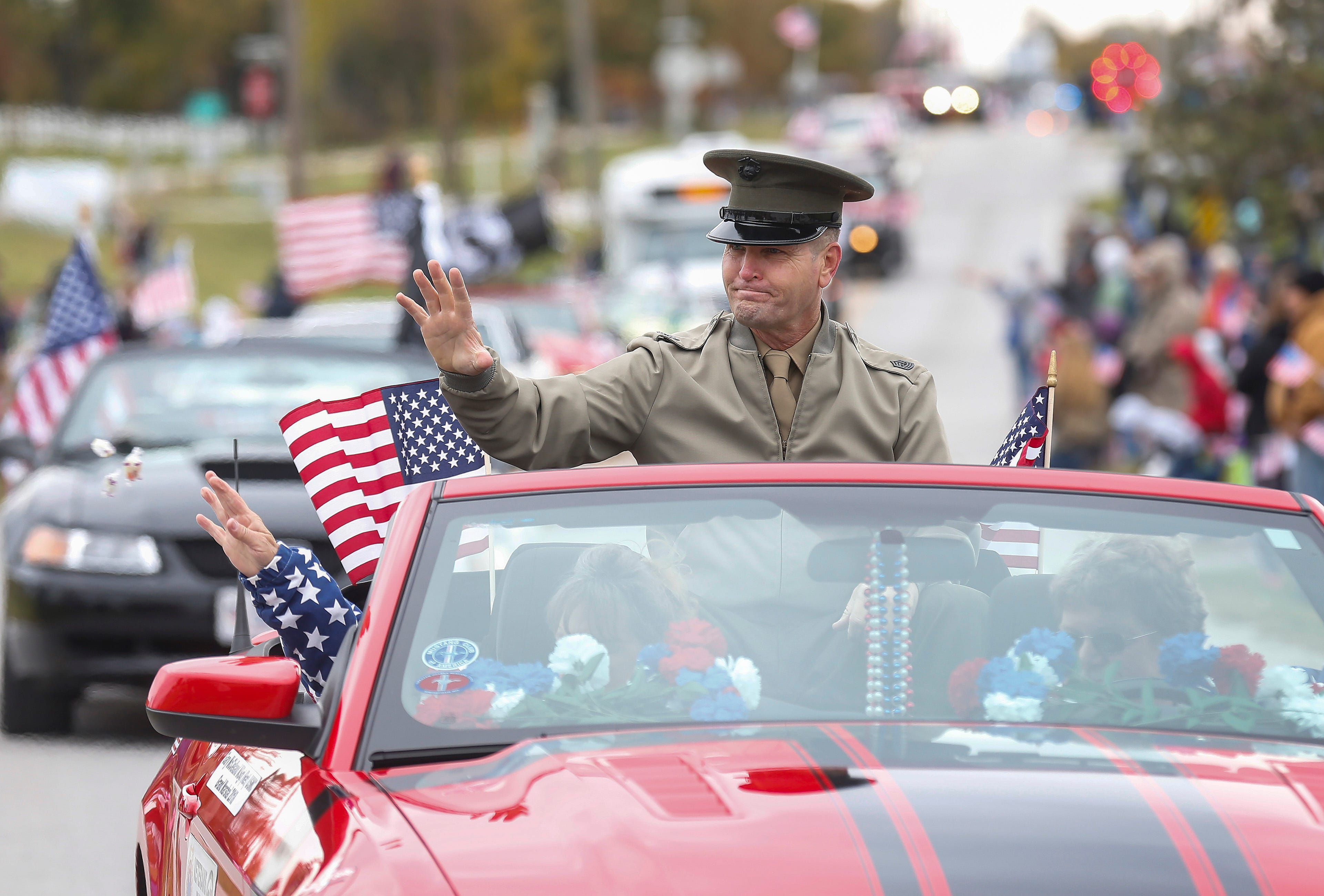 Grand Marshal of the 2nd Annual Western Greene County Veterans Day Parade retired Marine Msgt. Gary McClelland waves to the crowd in Willard for the on Saturday, Nov. 3, 2018.