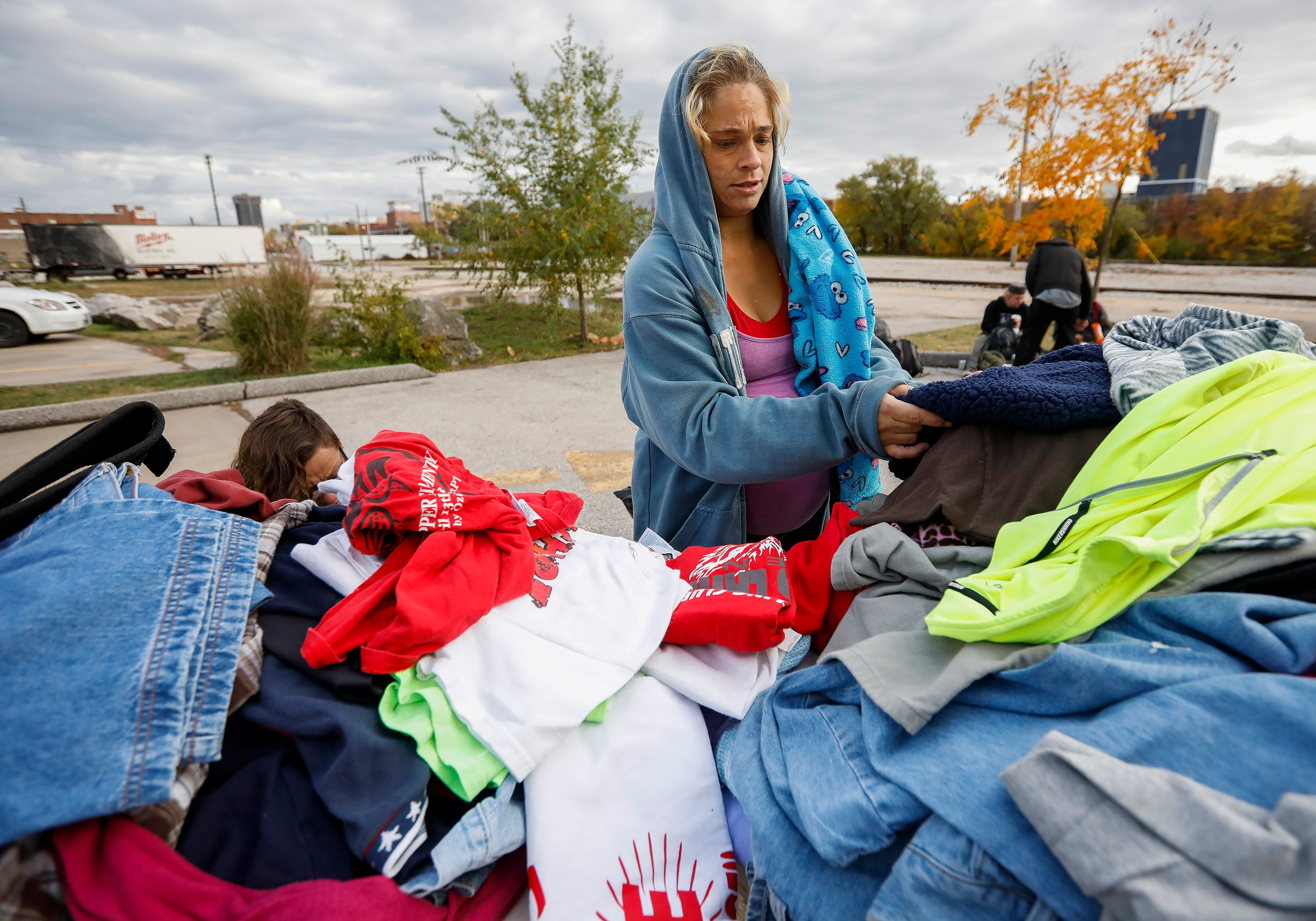 """""""Shorty"""" looks through donated clothing outside of the Gathering Tree on Friday, Nov. 2, 2018. The drop-in center, located inside the Vineyard Church at 634 W. Wall St., has closed."""