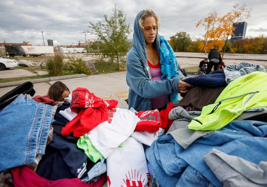 """Shorty"" looks through donated clothing outside of the Gathering Tree on Friday, Nov. 2, 2018. The drop-in center, located inside the Vineyard Church at 634 W. Wall St., has closed."