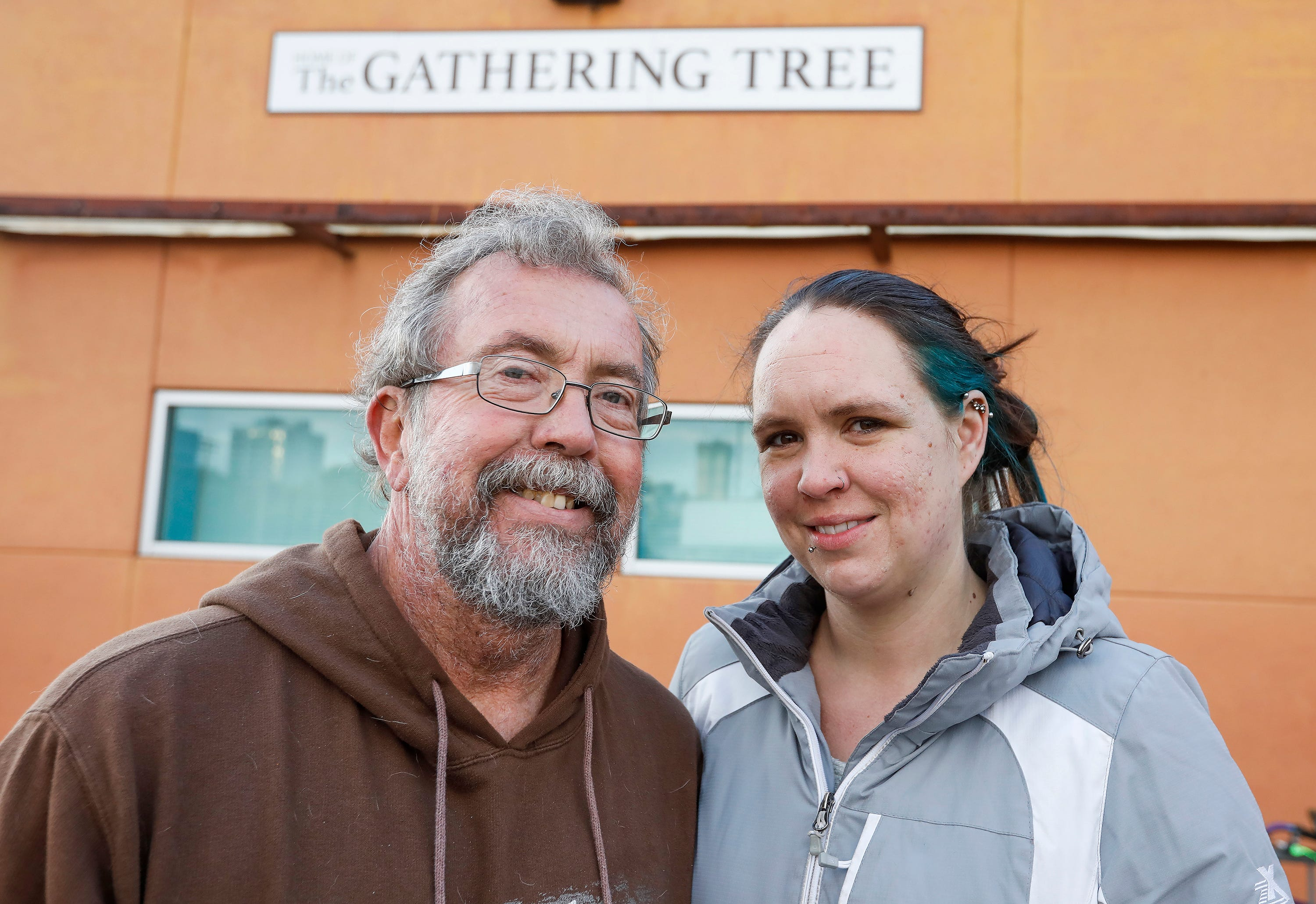 Ron Duncan and his fiancee, Erica Woolman. who are longtime volunteers,  stand outside of The Gathering Tree on Friday, Nov. 2, 2018. The drop-in center, which opened in 2016, has closed.