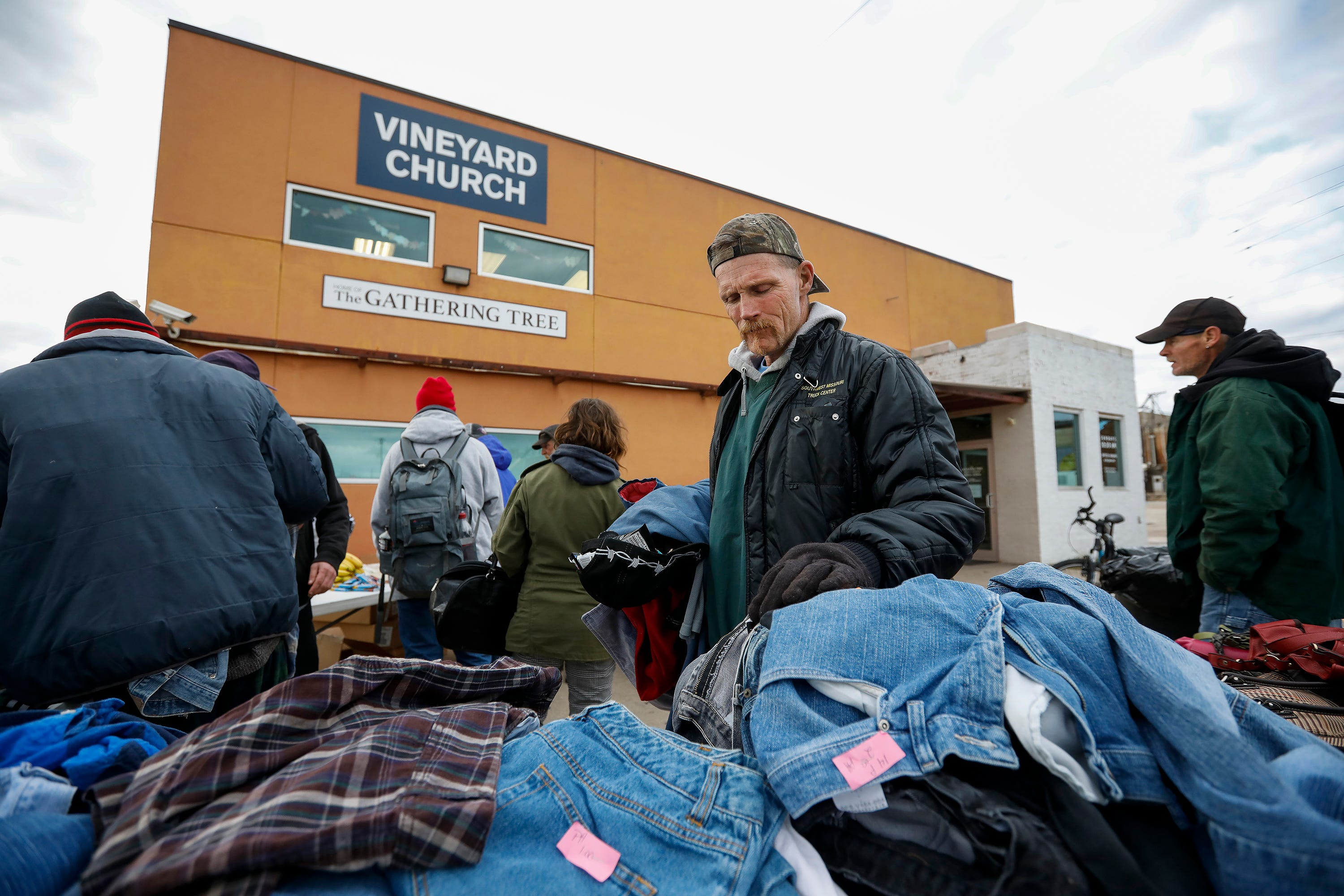 """""""It sucks, it really does,"""" said David Brownfield. """"A lot of us don't have a place to get out of the cold. It's a blow to the homeless community."""" Brownfiled looks through donated clothing outside of the Gathering Tree on Friday, Nov. 2, 2018. The drop-in center, located in the Vineyard Church at 634 W. Wall St., has closed."""