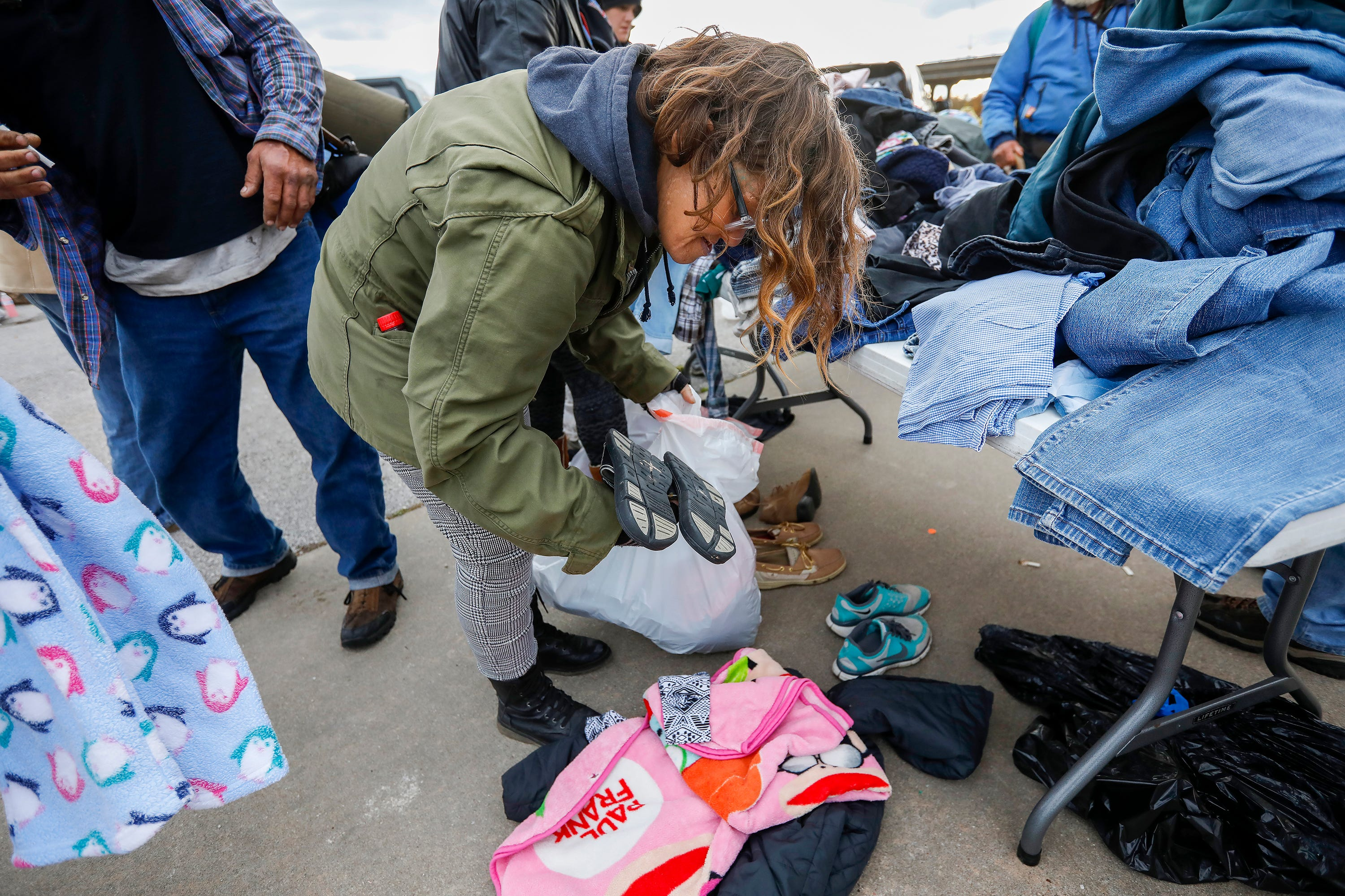 """""""Punky"""" gathers together clothing items outside of the Gathering Tree on Friday, Nov. 2, 2018. The drop-in center, located at 634 W. Wall St., has closed."""