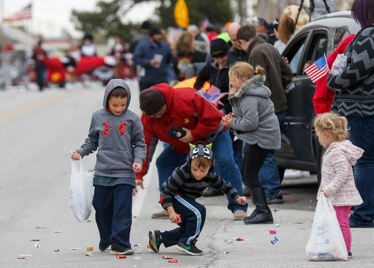 Kids scramble to pick up candy in Willard during the 2nd Annual Western Greene County Veterans Day Parade on Saturday, Nov. 3, 2018.