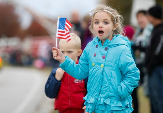 Eleah Loeber, 7, and her cousin Jaxon Stack, 3, watch the 2nd Annual Western Greene County Veterans Day Parade in Willard on Saturday, Nov. 3, 2018.