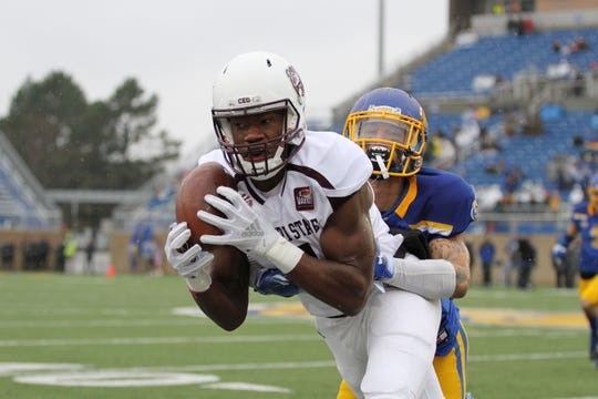 Missouri State's Jordan Murray (9) makes a grab on the sidelines during the first quarter of the match up with South Dakota State Saturday afternoon at Dan J. Dykhouse Stadium in Brookings, SD.