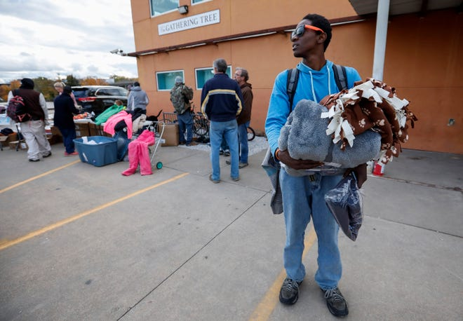 Dekiah Rose looks around for a friend he was supposed to meet outside of the Gathering Tree on Friday, Nov. 2, 2018. The drop-in center, located at 634 W. Wall St., has closed.