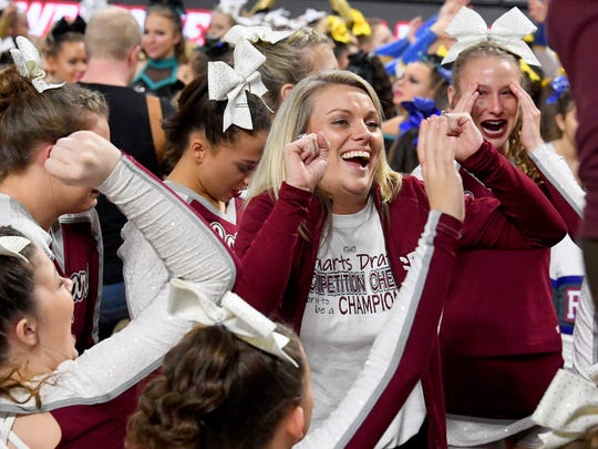 Stuarts Draft head coach Tammy Carter dances with her team as they wait to hear the results in the VHSL Competition Cheer Championships in Richmond on Saturday, Nov. 3, 2018.