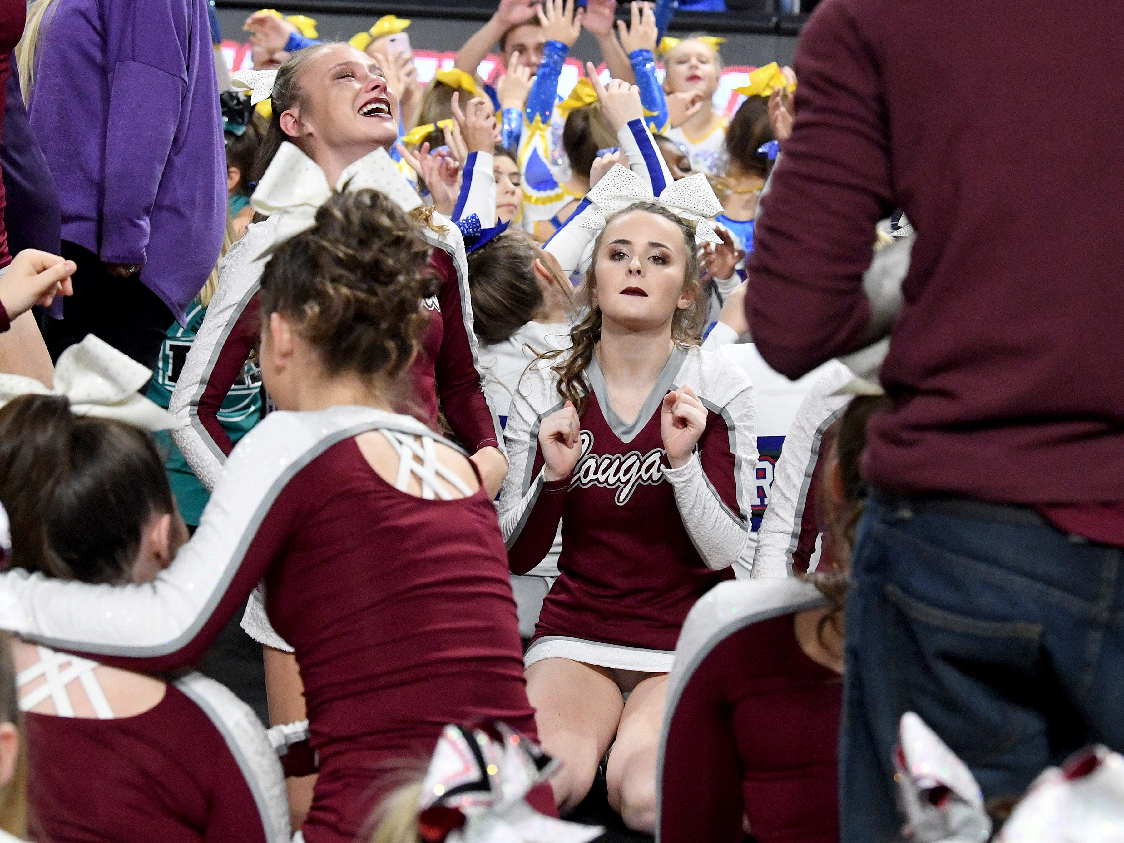 Stuarts Draft's competition cheer team wait for the winners to be announced for the Class 2 division in the VHSL Competition Cheer Championships in Richmond on Saturday, Nov. 3, 2018.