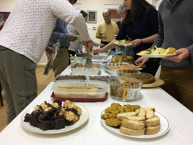 A spread of food was shared among Temple House of Israel community members as they remembered the Pittsburgh synagogue shooting.