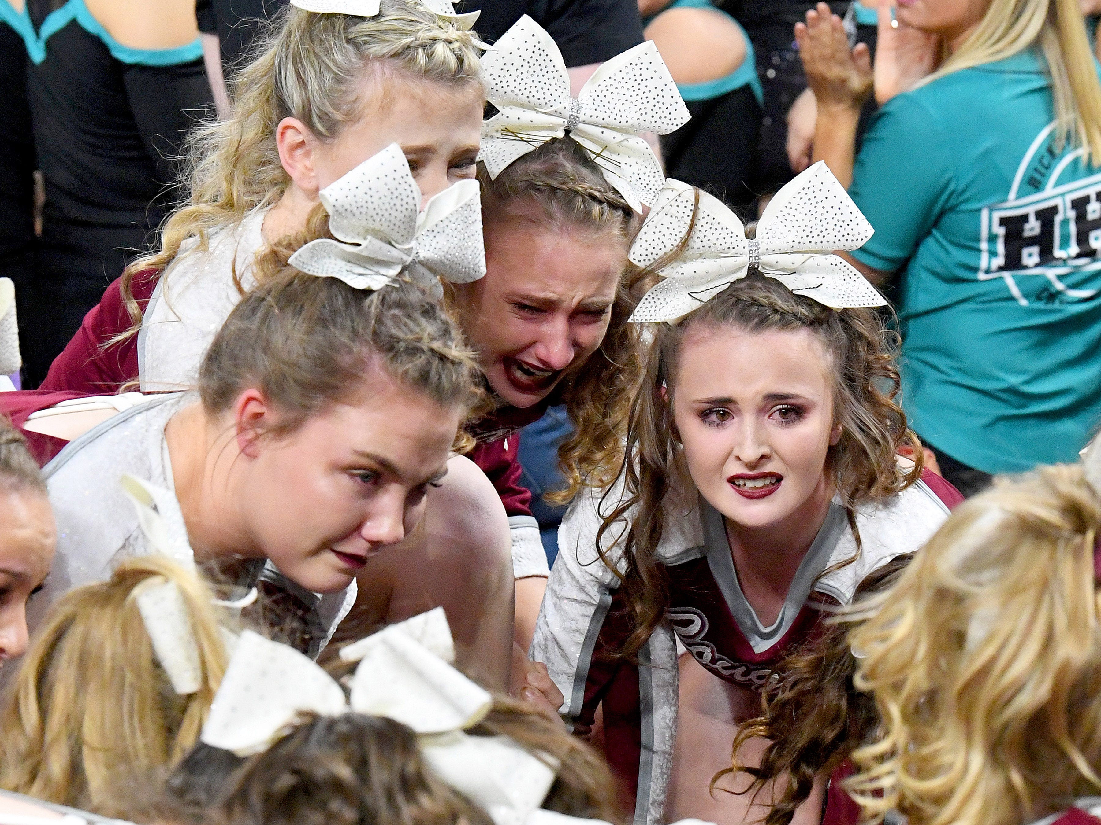 Members of the Stuarts Draft's competition wait to officially hear they have won the Class 2 championship during the VHSL Competition Cheer Championships in Richmond on Saturday, Nov. 3, 2018.