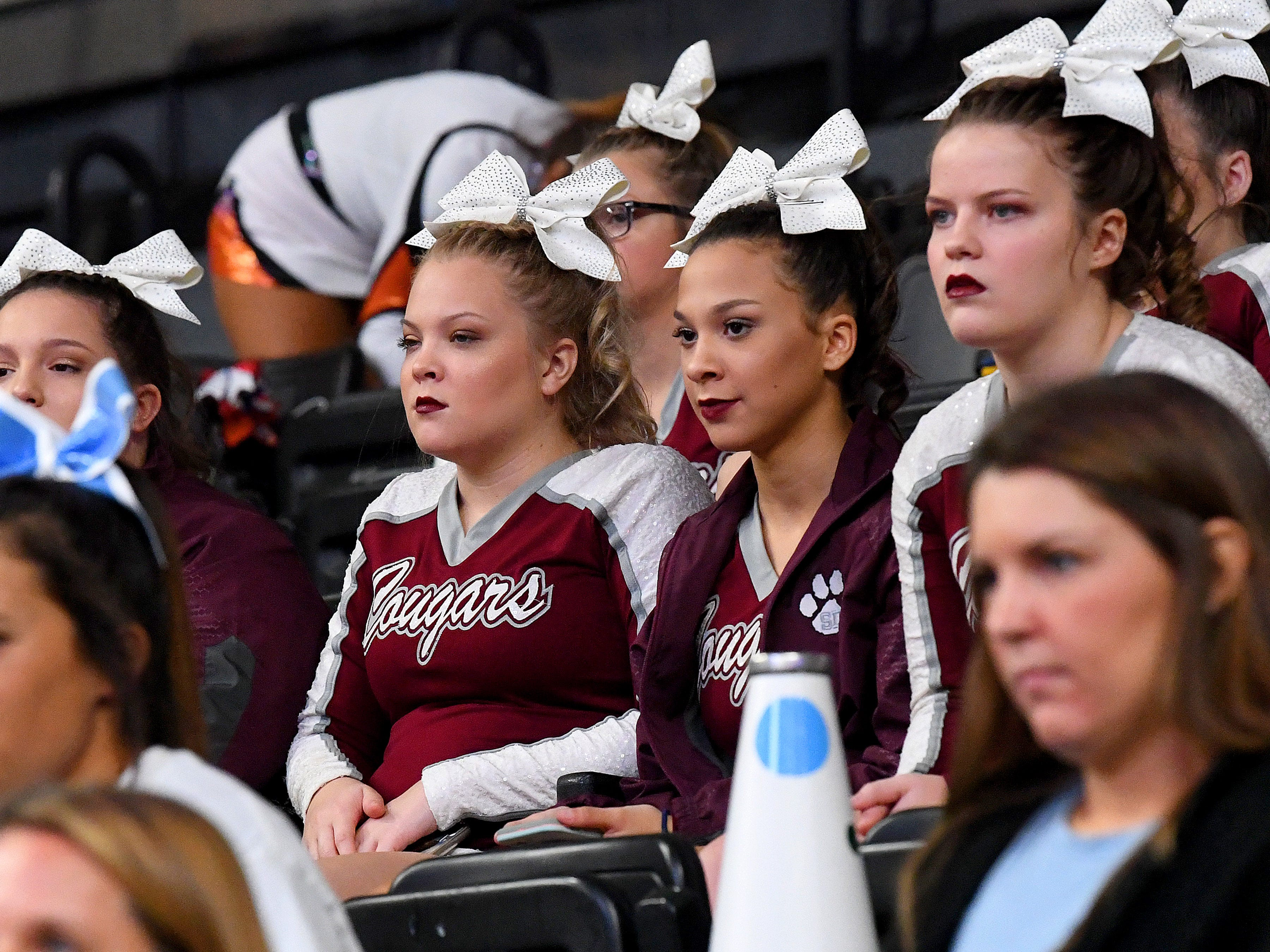 Stuarts Draft cheerleaders watch as another team competes down on the floor as they wait for their turn in the first round of the VHSL Competition Cheer Championships in Richmond on Saturday, Nov. 3, 2018.
