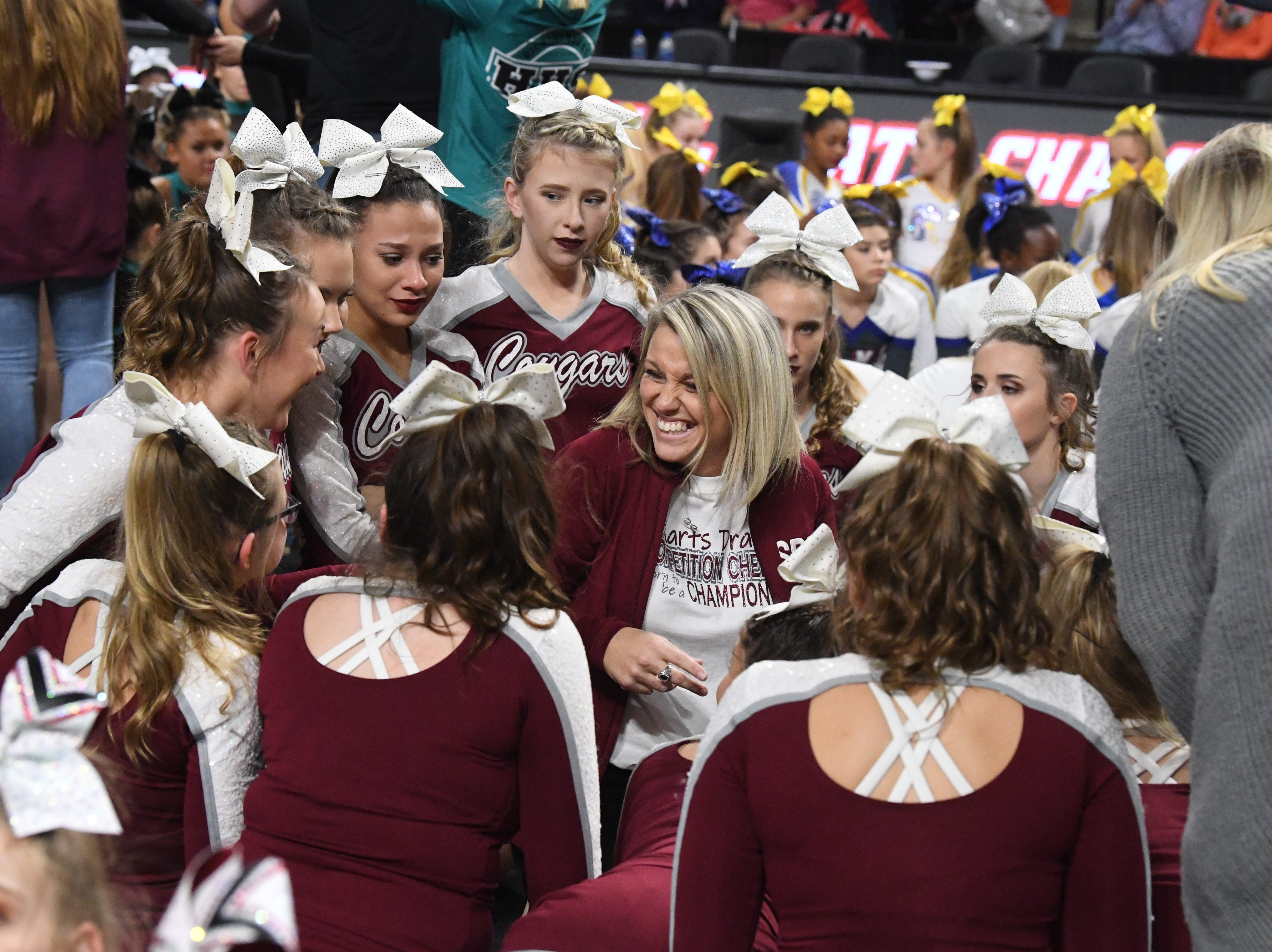 Stuarts Draft head coach Tammy Carter is with her team as they wait to hear the results in the VHSL Competition Cheer Championships in Richmond on Saturday, Nov. 3, 2018.