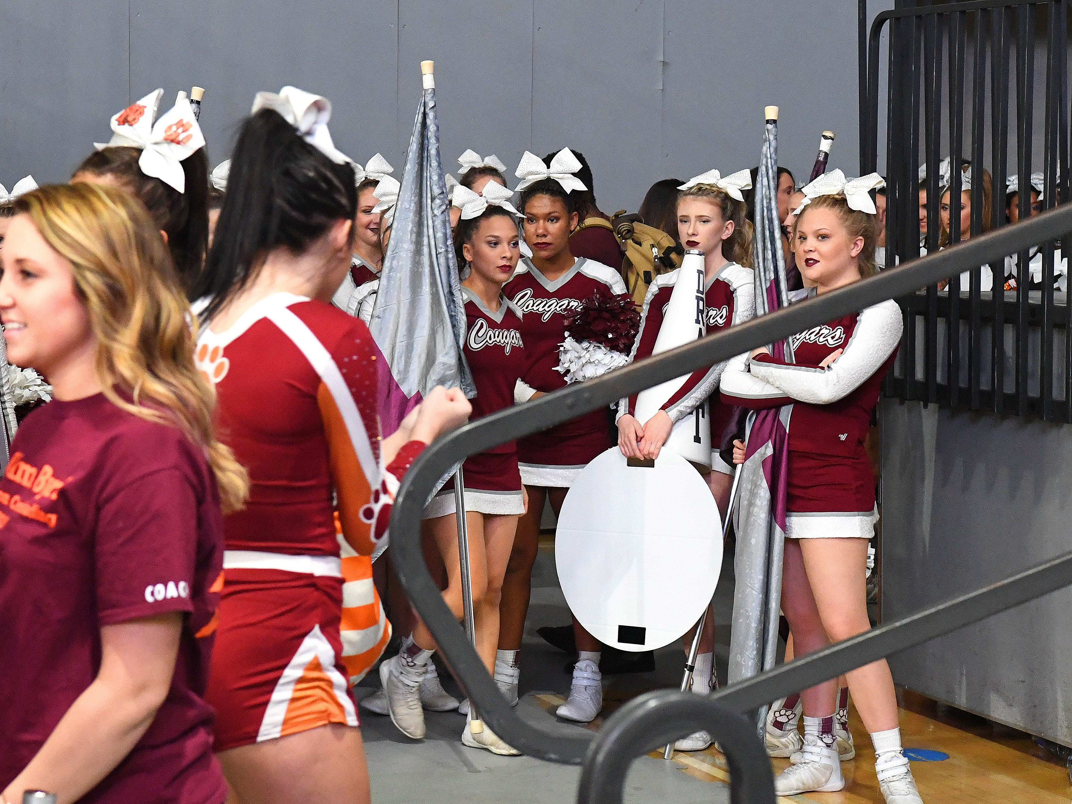 Stuarts Draft's competition cheer team waits their turn to compete in the event finals during the VHSL Competition Cheer Championships in Richmond on Saturday, Nov. 3, 2018.
