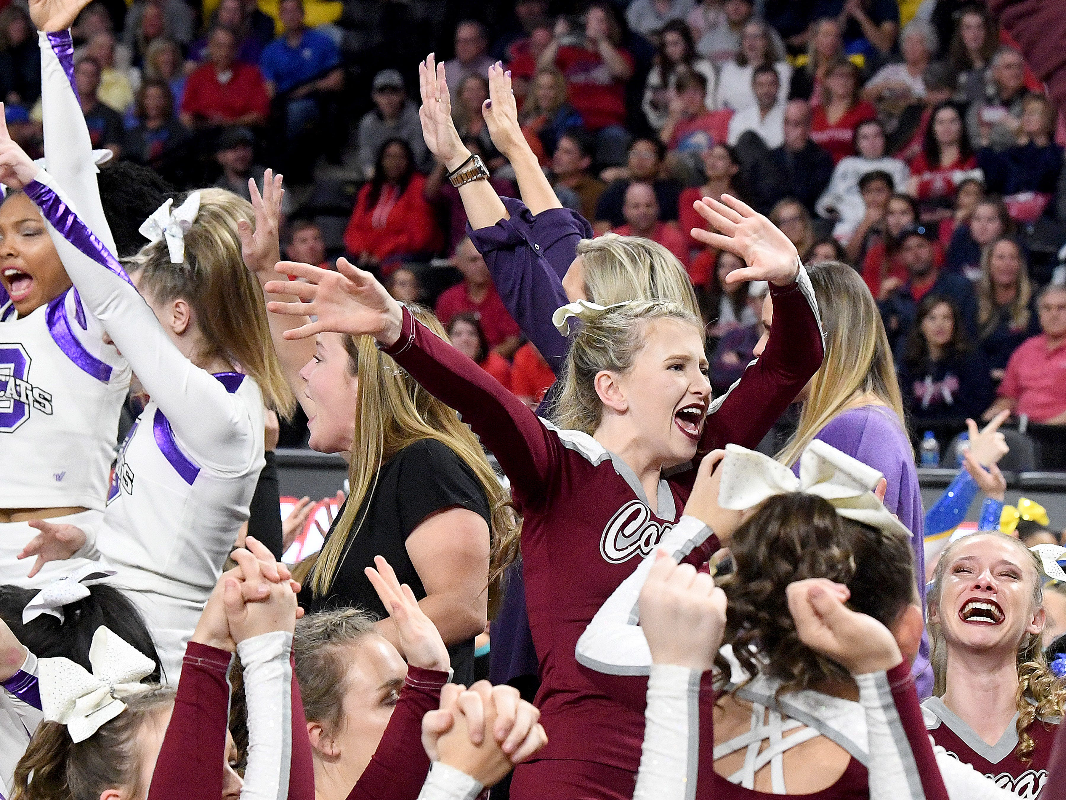 A Stuarts Draft's competition cheerleader dances to the music while waiting for the results to be announced in the VHSL Competition Cheer Championships in Richmond on Saturday, Nov. 3, 2018.