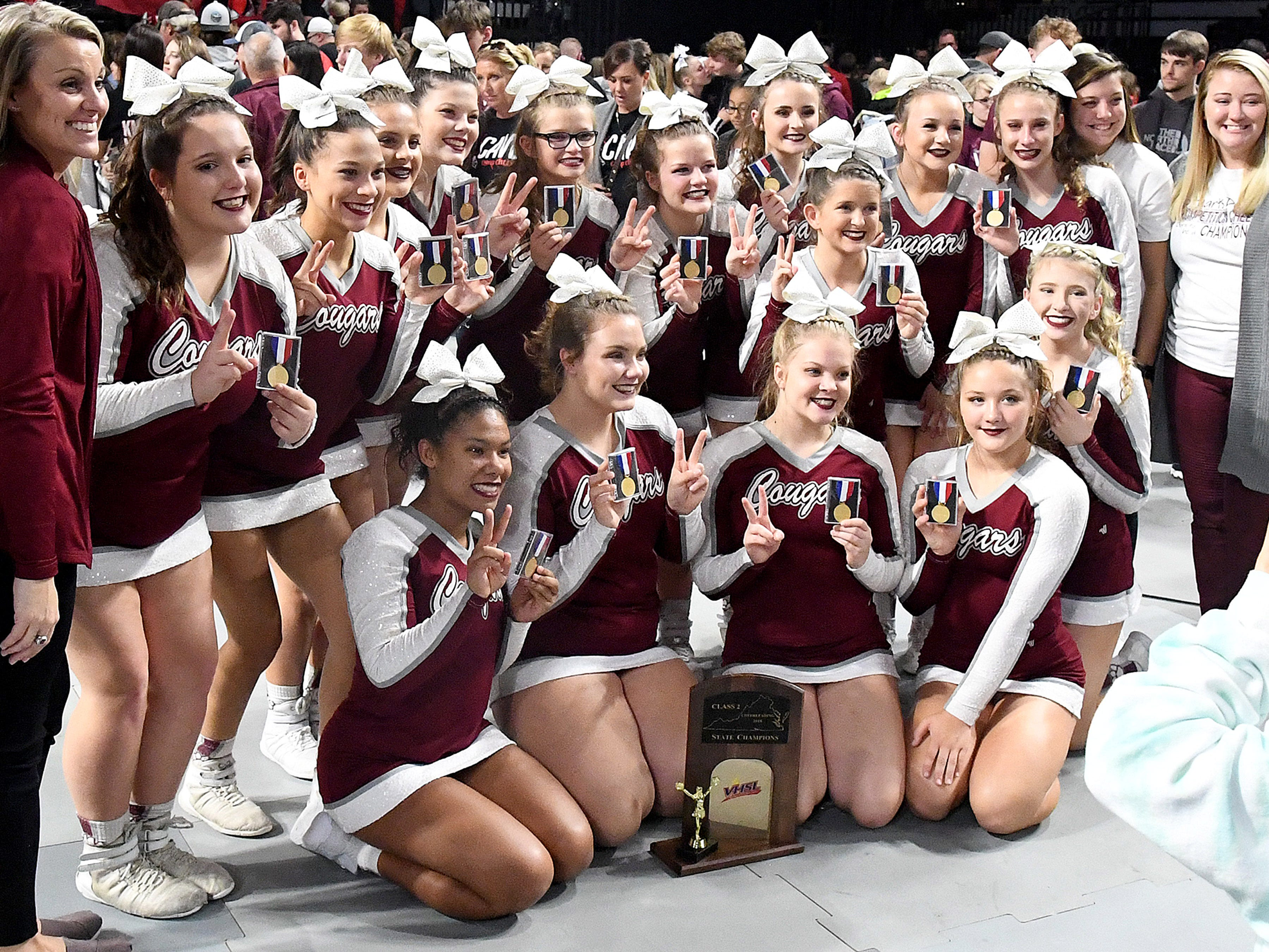 Stuarts Draft's competition cheer team celebrates winning the Class 2 state title in the VHSL Competition Cheer Championships in Richmond on Saturday, Nov. 3, 2018.
