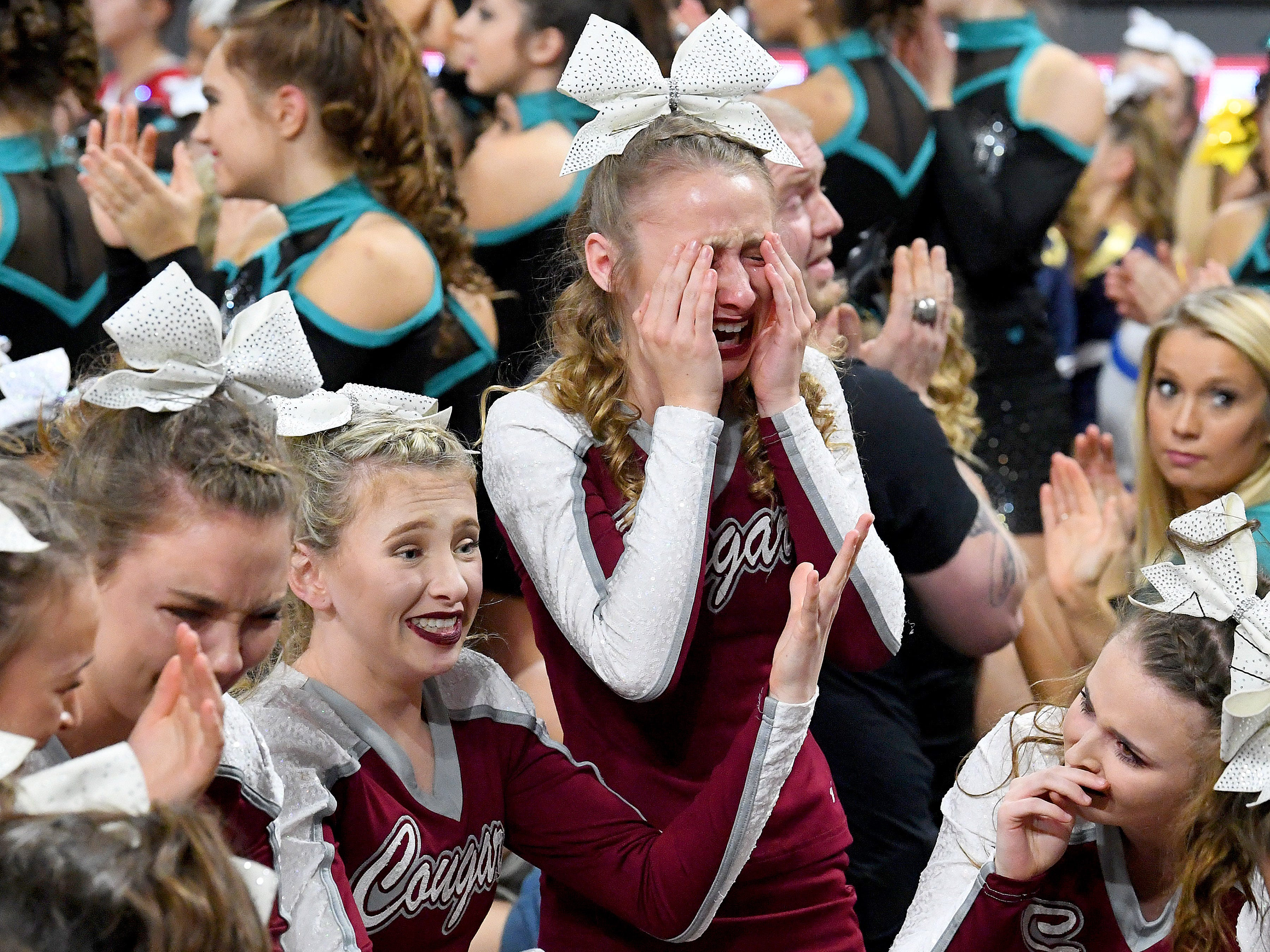 Members of the Stuarts Draft's competition cheer team realize as second place is announced that they will be the winners of the Class 2 division in the VHSL Competition Cheer Championships in Richmond on Saturday, Nov. 3, 2018.