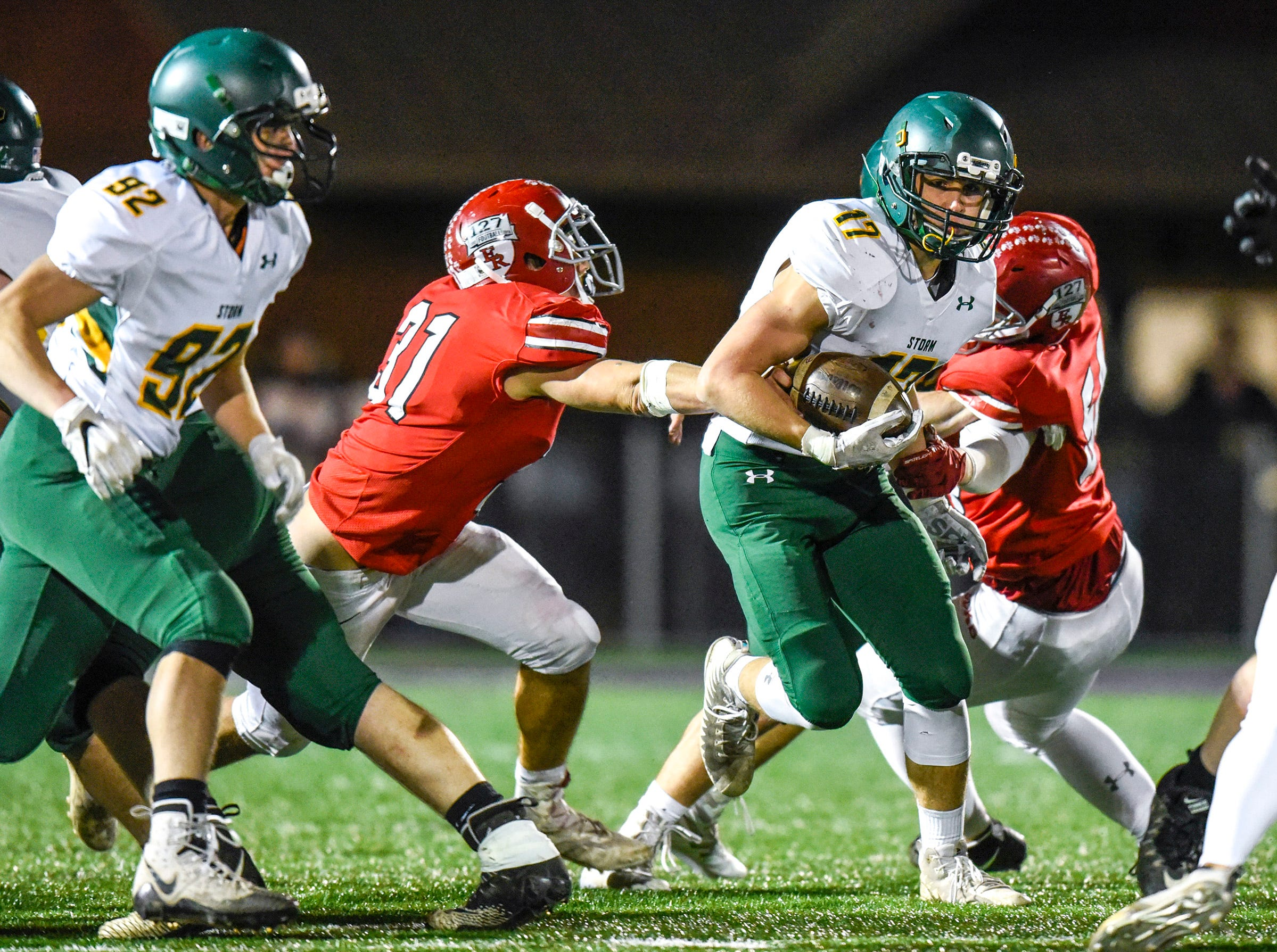 Sauk Rapids running back Jake Ackerman carries the ball against Elk River during the first half Friday, Nov. 2, in the Section 6-5A championship at Buffalo High School.
