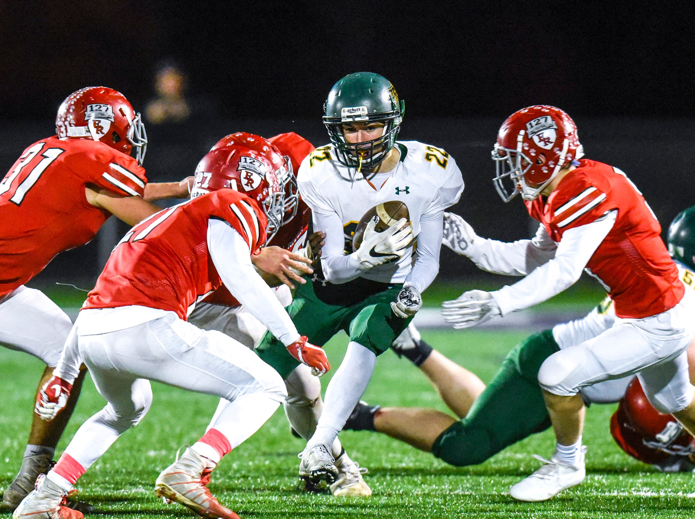 Sauk Rapids' Christian Rodriguez is tackled by Elk River on a run during the first half Friday, Nov. 2, in the Section 6-5A championship at Buffalo High School.
