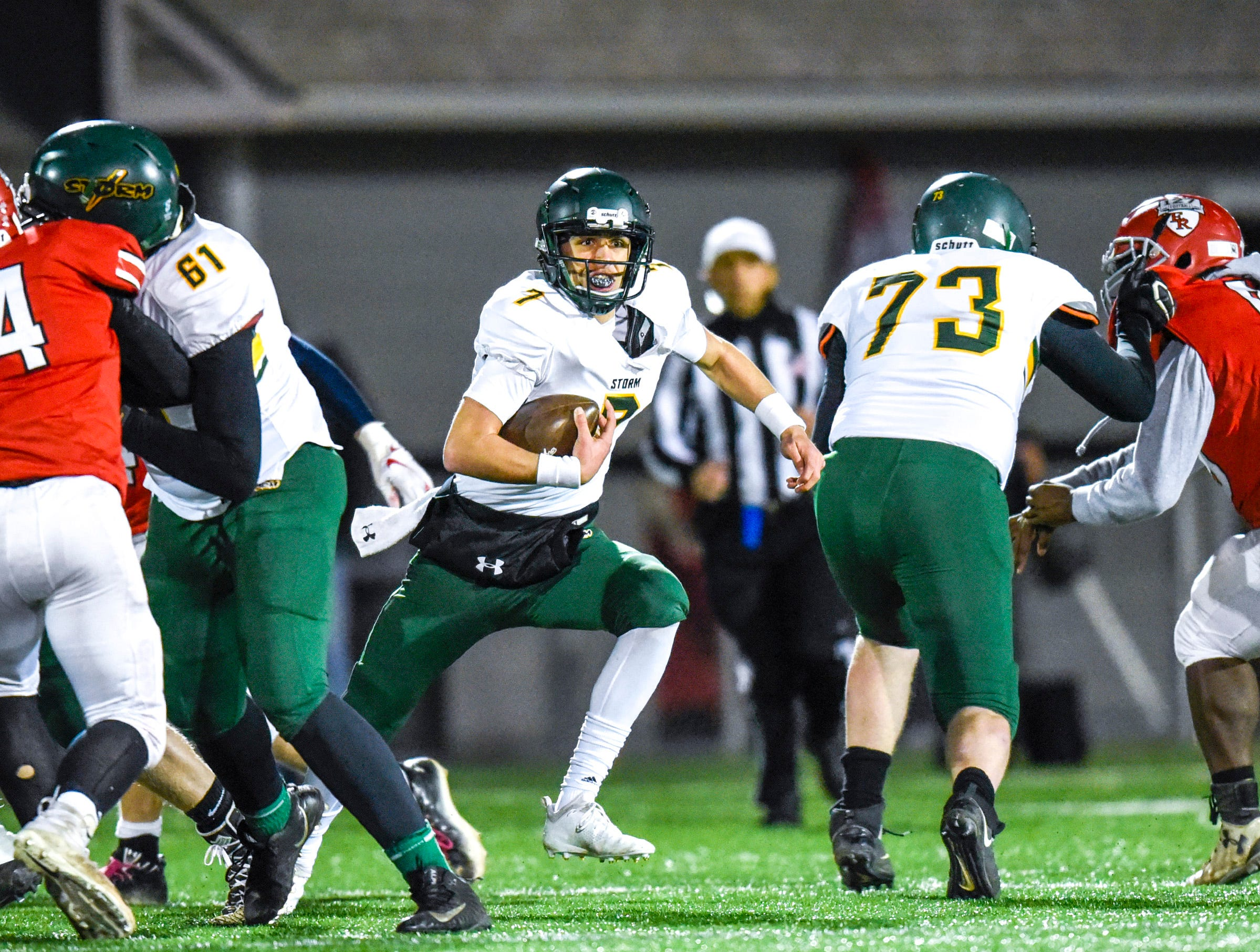 Sauk Rapids quarterback Cade Milton-Baumgardner runs with ball against Elk River during the first half Friday, Nov. 2, in the Section 6-5A championship at Buffalo High School.