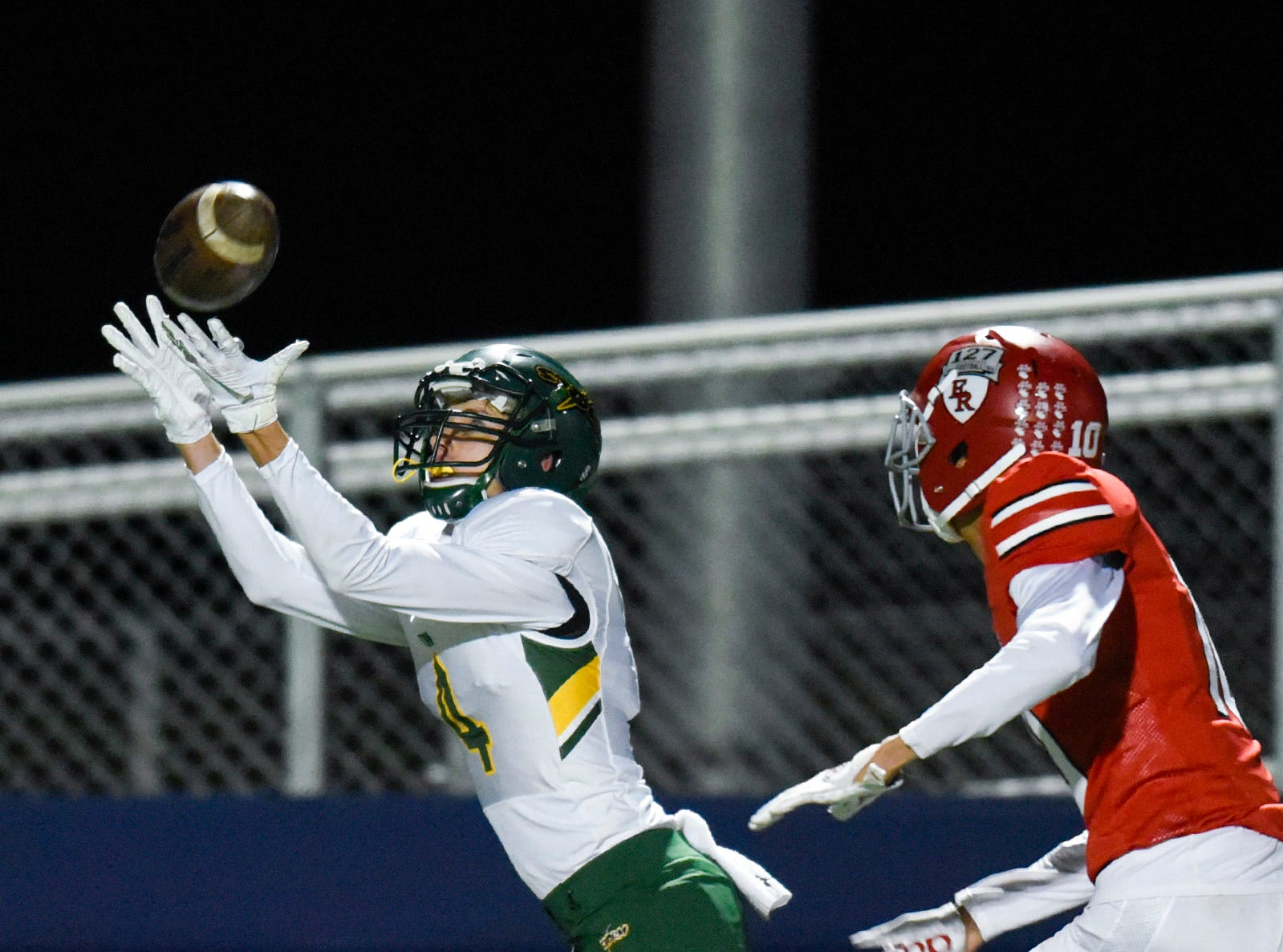 Sauk Rapids wide receiver Kobe Lee tries to grab a pass against Elk River during the first half Friday, Nov. 2, in the Section 6-5A championship at Buffalo High School.