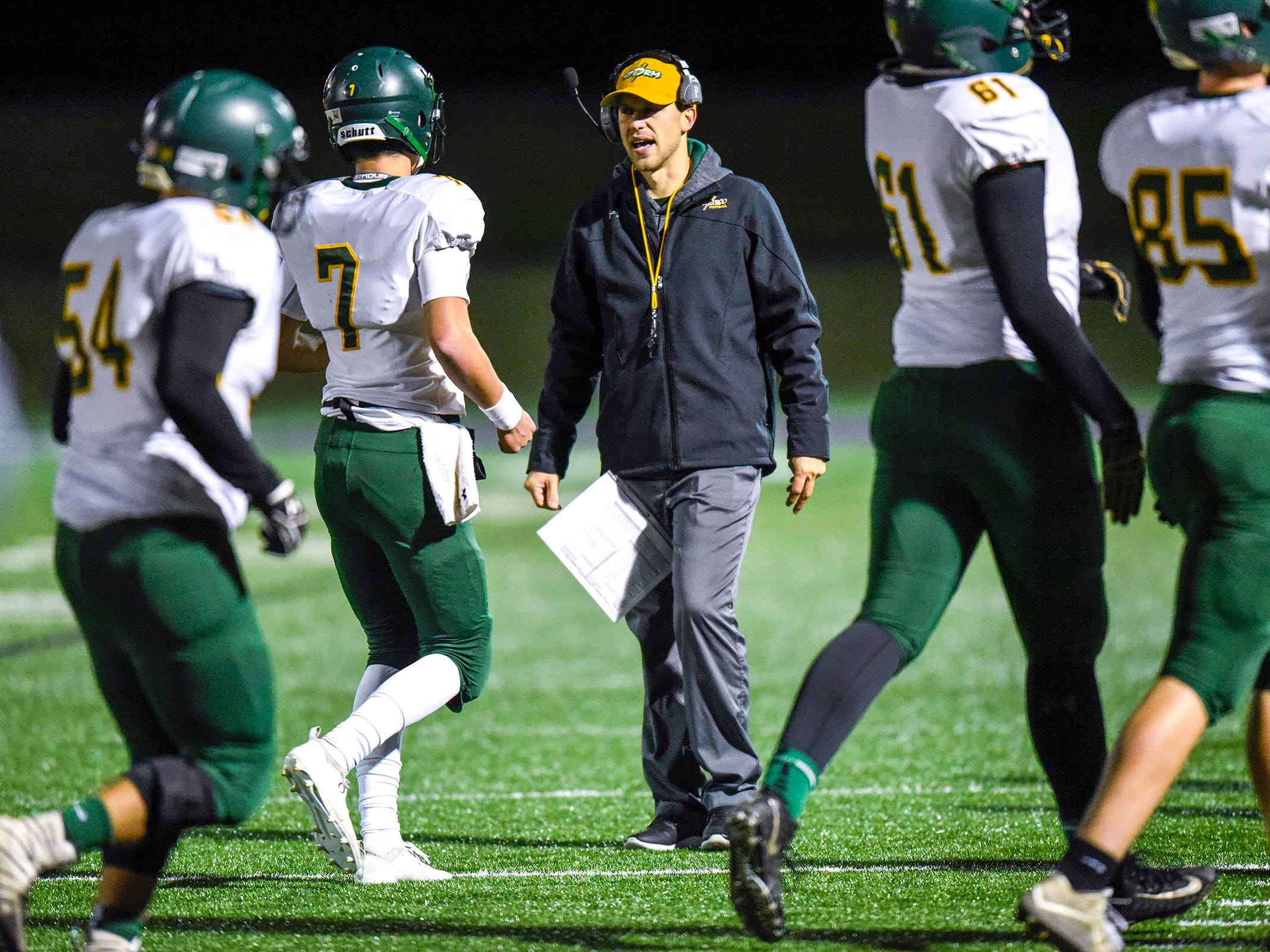 Sauk Rapids head coach Phillip Klaphake talks with players as they come off the field during the first half Friday, Nov. 2, in the Section 6-5A championship at Buffalo High School.