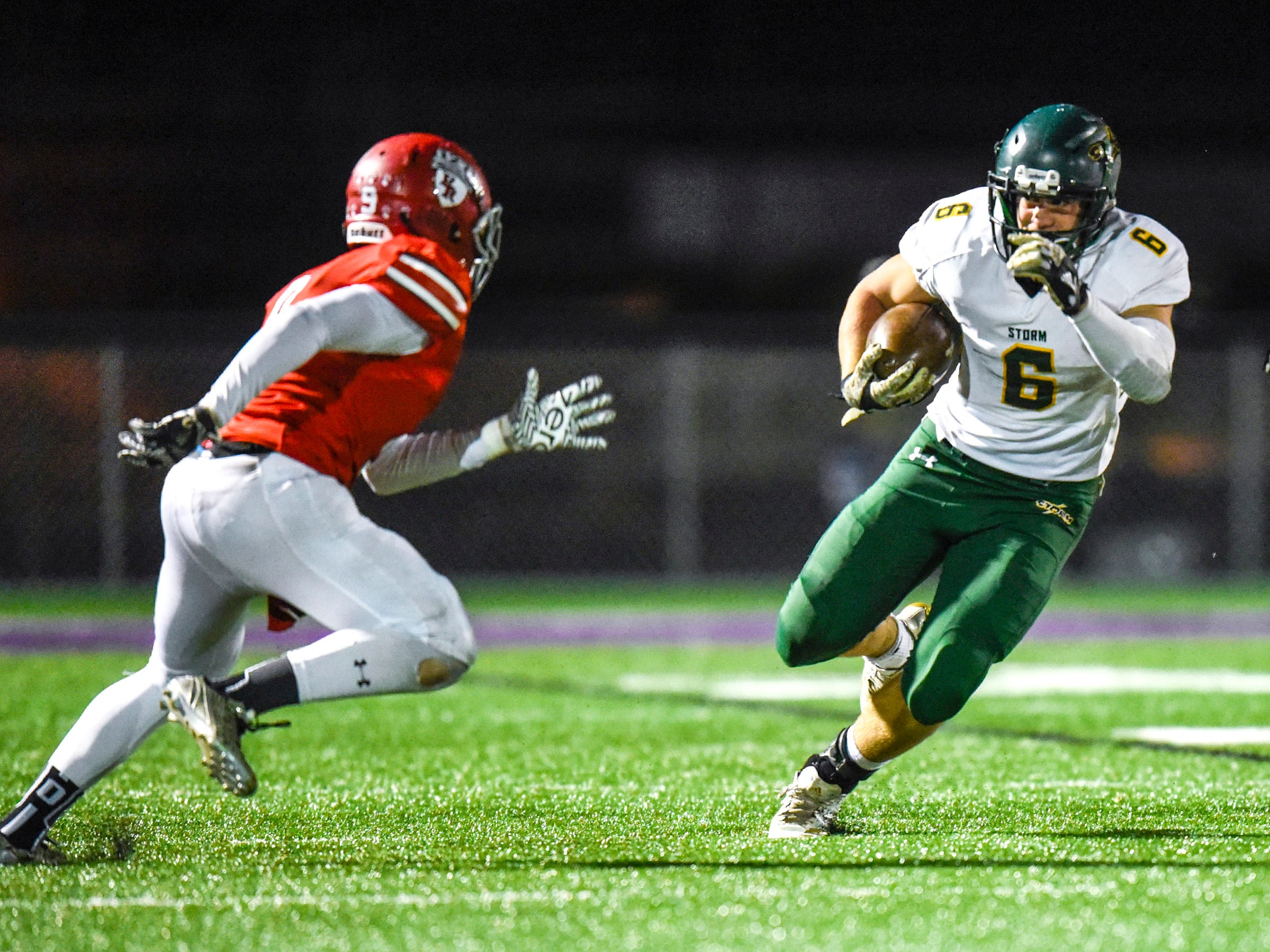 Sauk Rapids running back J.D. Bates tries to outrun the Elk River defense during the first half Friday, Nov. 2, in the Section 6-5A championship at Buffalo High School.