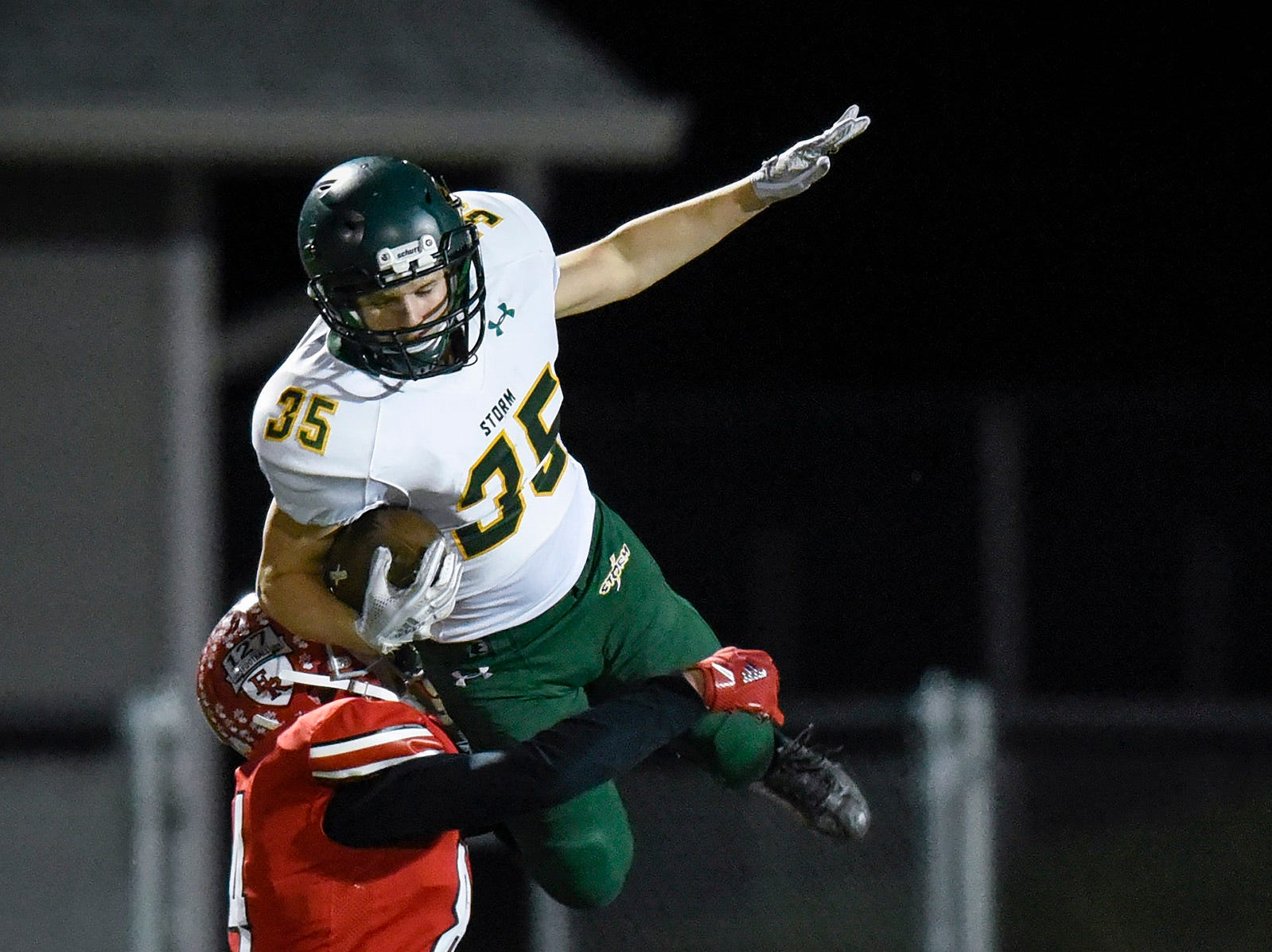 Sauk Rapids wide receiver Zach Storms tries to avoid being tackled against Elk River during the first half Friday, Nov. 2, in the Section 6-5A championship at Buffalo High School.