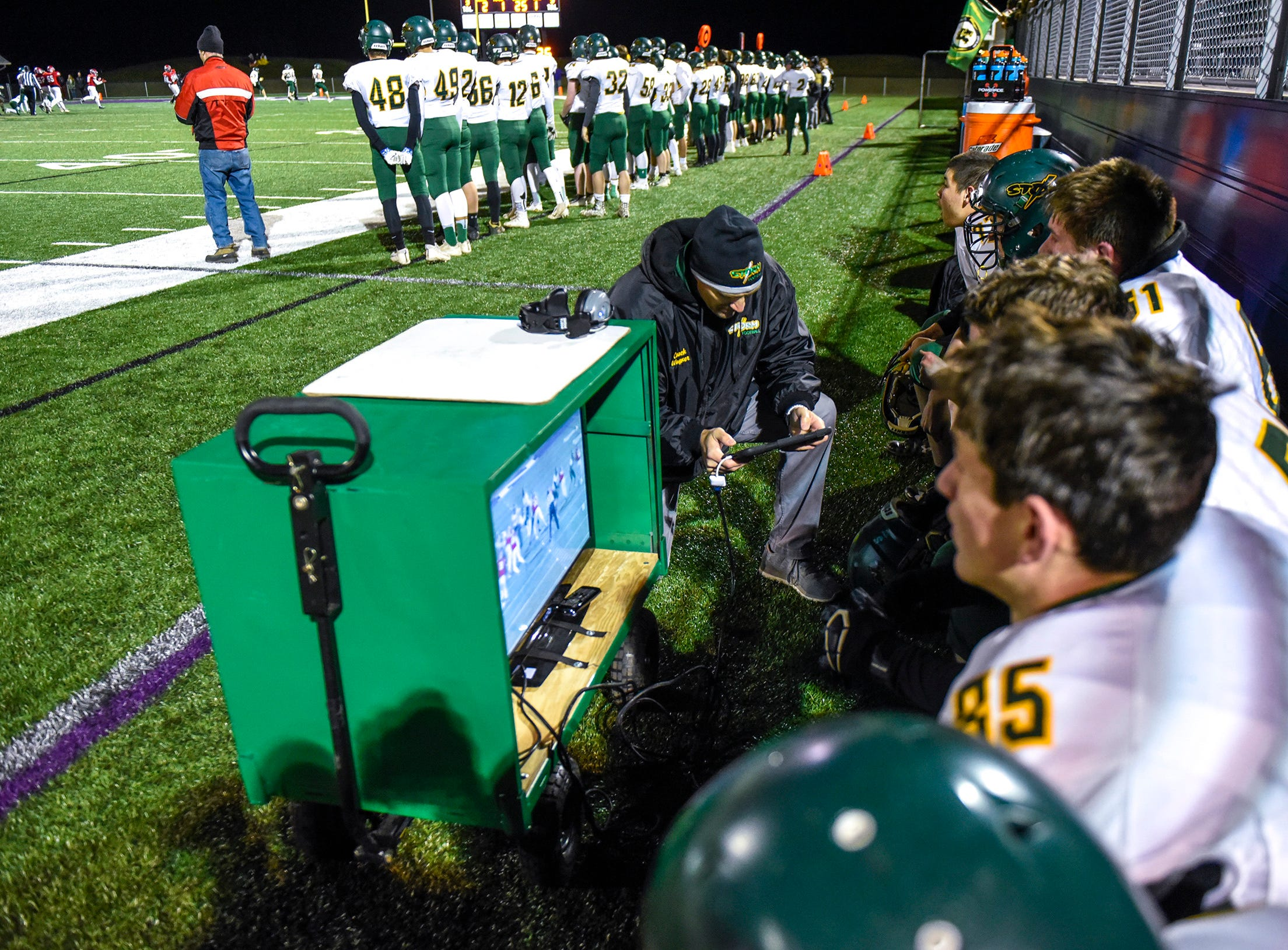 Sauk Rapids players watch replays on the sidelines against Elk River during the first half Friday, Nov. 2, in the Section 6-5A championship at Buffalo High School.