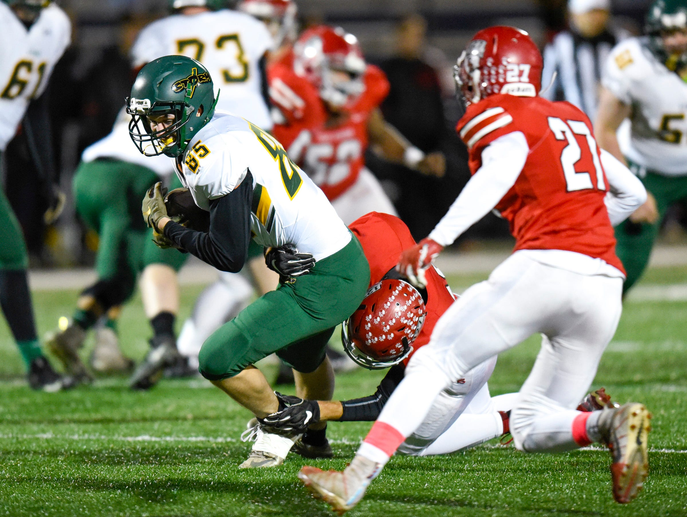Sauk Rapids tight end Josh Schloe is brought down by the Elk River defense during the first half Friday, Nov. 2, in the Section 6-5A championship at Buffalo High School.