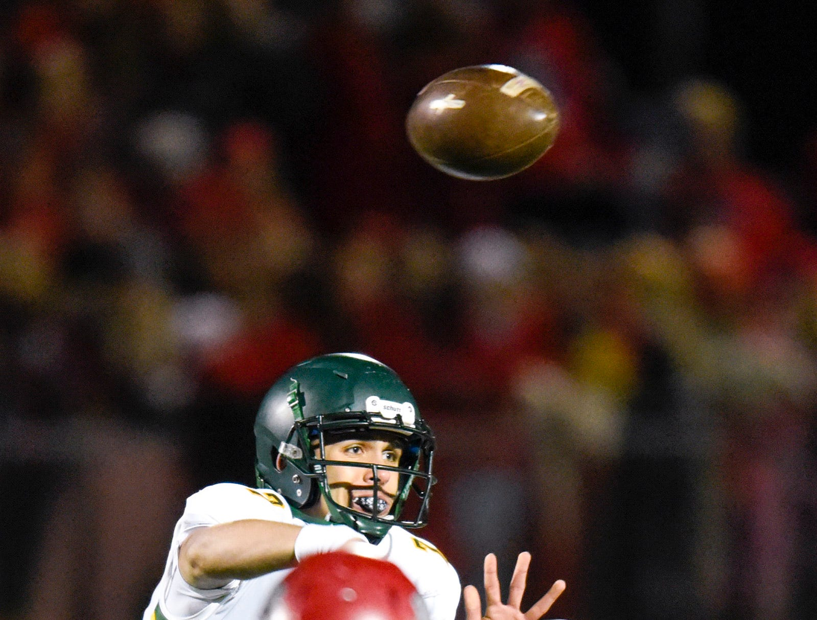 Sauk Rapids quarterback Cade Milton-Baumgardner throws against Elk River during the first half Friday, Nov. 2, in the Section 6-5A championship at Buffalo High School.