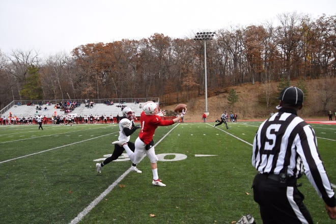Joey Eckhoff makes a spectacular catch for St. John's in the first quarter Saturday at Clemens Stadium in Collegeville.