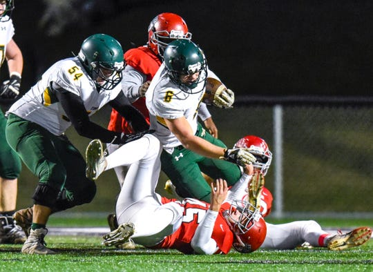 Sauk Rapids running back J.D. Bates is tackled by the Elk River defense during the first half Friday, Nov. 2, in the Section 6-5A championship at Buffalo High School.