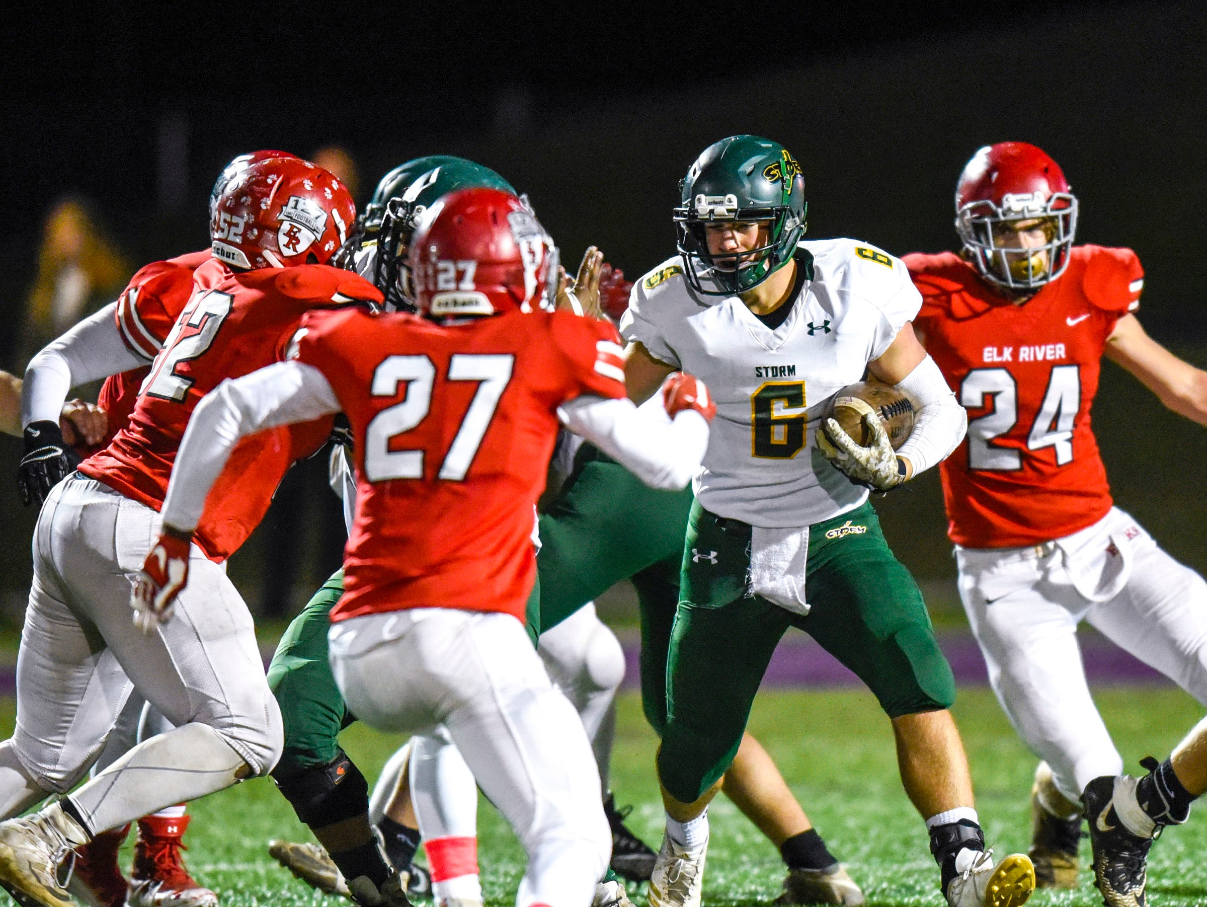 Sauk Rapids' J.D. Bates looks for a way through the Elk River defense during the first half Friday, Nov. 2, in the Section 6-5A championship at Buffalo High School.