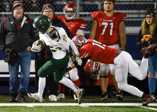Sauk Rapids' Christian Rodriguez gets pulled out of bounds by Elk River's Logan Enkhaus during the first half Friday, Nov. 2, in the Section 6-5A championship at Buffalo High School.