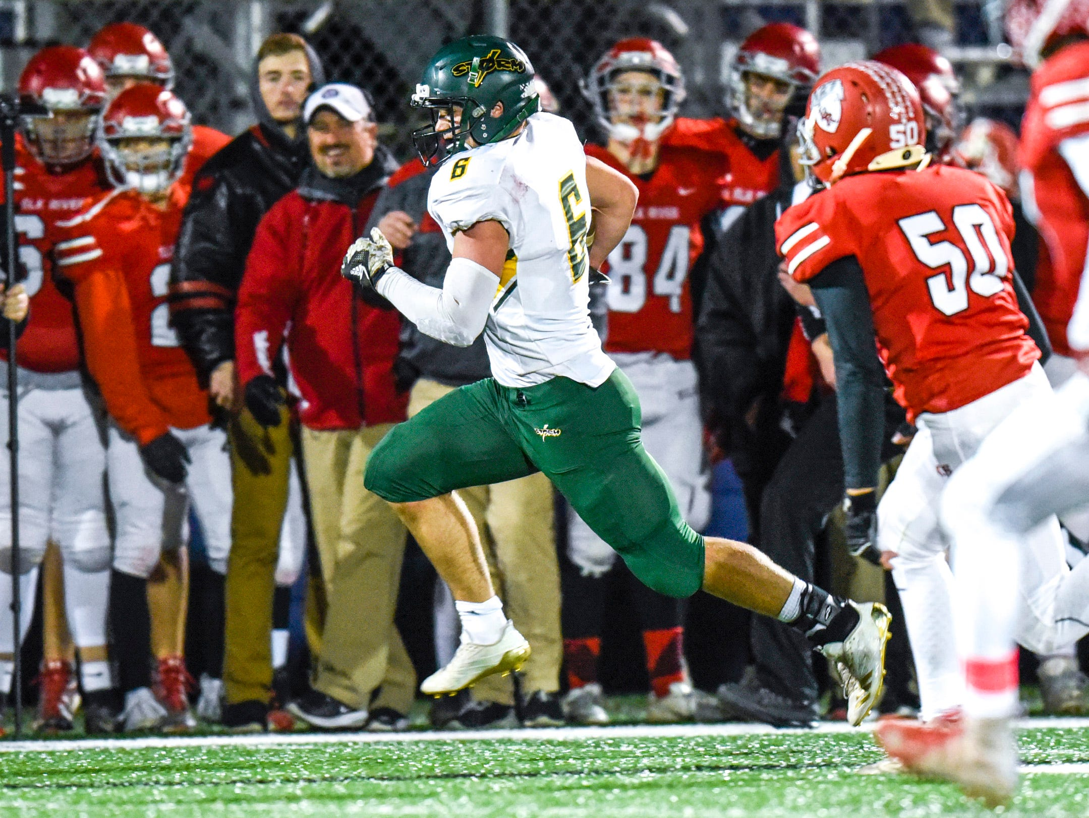 Sauk Rapids' J.D. Bates runs down the sideline against Elk River during the first half Friday, Nov. 2, in the Section 6-5A championship at Buffalo High School.